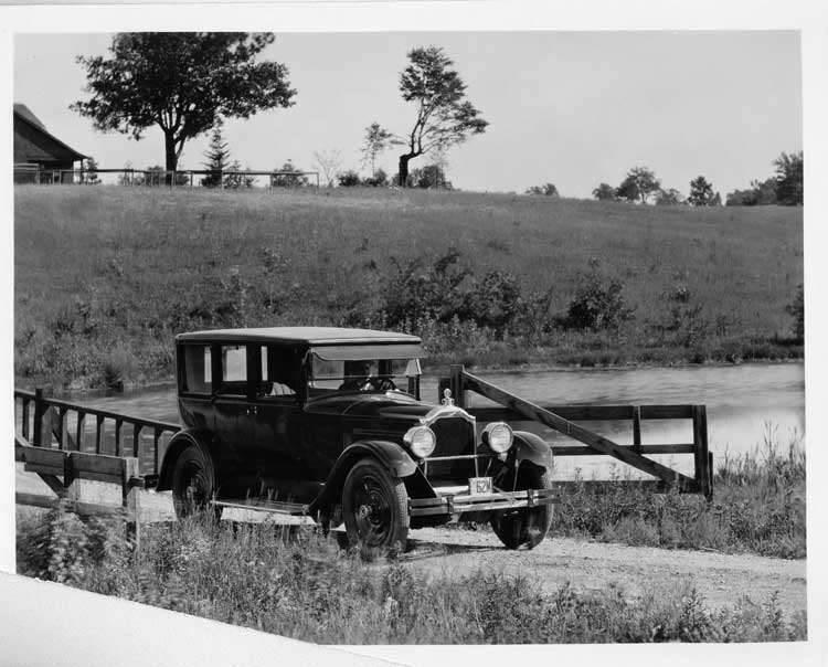 1925 Packard sedan crossing country, wooden bridge