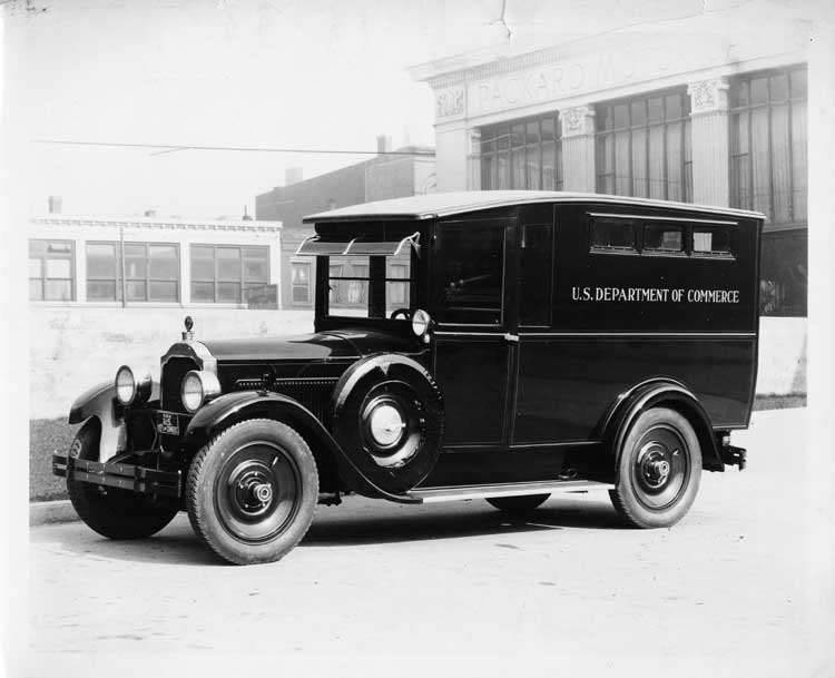 1925-1926 Packard special radio van parked in front of Packard Motor Car Co. building