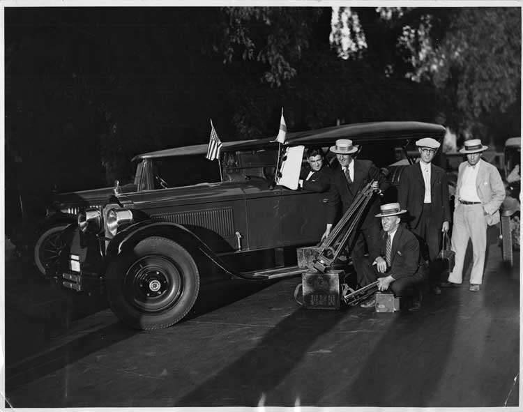 1925-1926 Packard touring car with newsreel cameramen in Riverside, Calif.