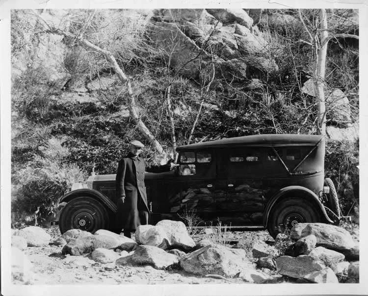1925-1926 Packard touring sedan on country road, top raised, side curtains in place