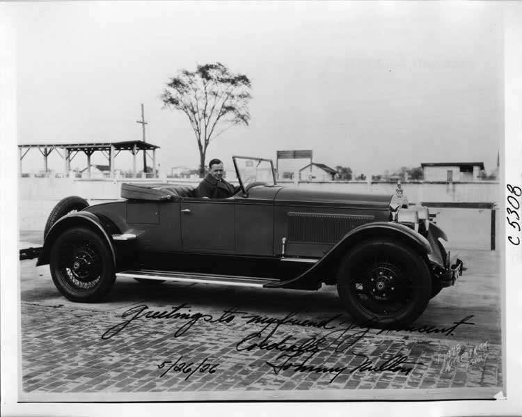 1925 Packard roadster, nine-tenths right front view, race car driver Tommy Milton at wheel