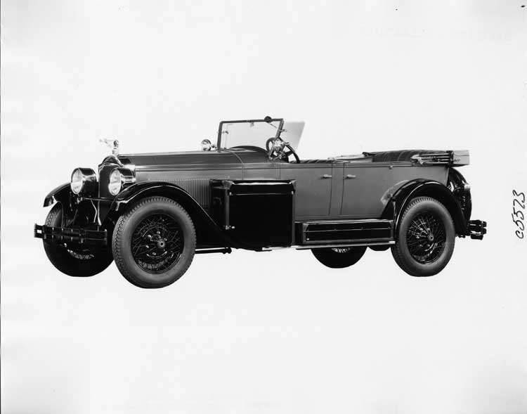 1925 Packard two-toned touring car, storage pieces displayed on running board