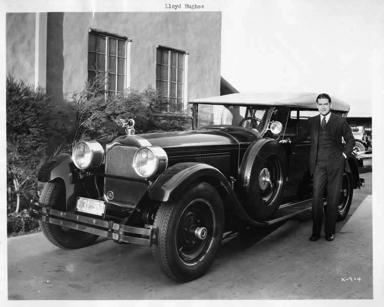 1925-1926 Packard sport model, front view, top raised, Lloyd Hughes standing at driver's door