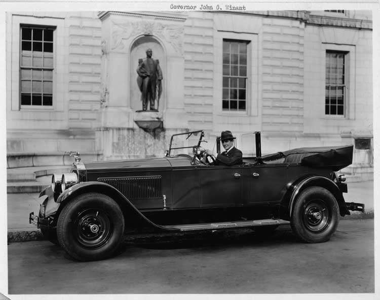 1925-1926 Packard touring car parked on street with New Hampshire governor, John G. Winant
