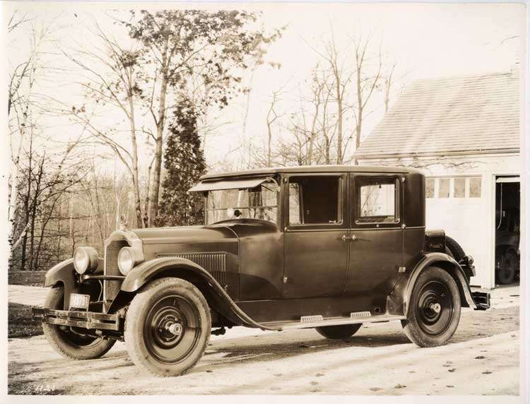 1925-1926 Packard club sedan parked in front of garage