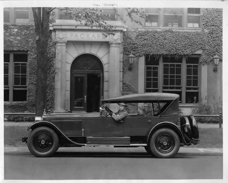 1925-1926 Packard sport model parked in front of Packard building, General Billy Mitchell driver