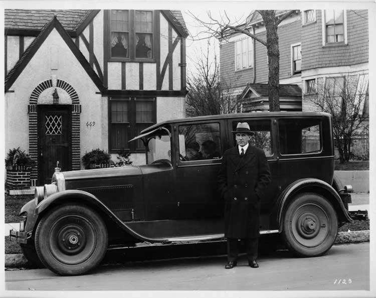 1925-1926 Packard sedan, owner Otto Mathie at driver's door