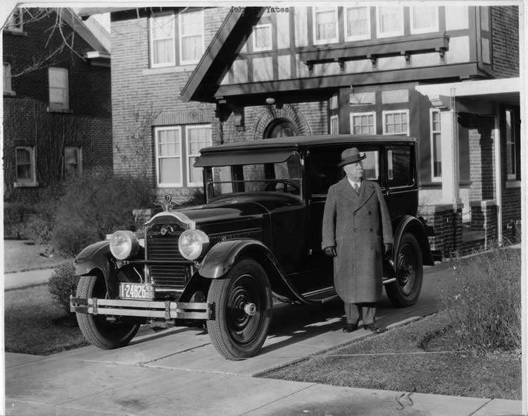 1925-1926 Packard sedan, owner Jno. T. Yates standing at driver's door
