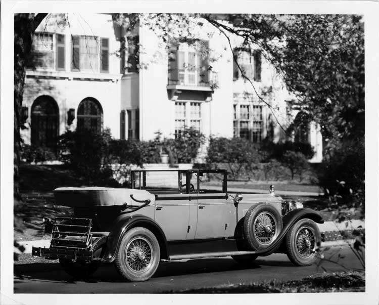 1928 Packard convertible sedan, four-fifths right rear view, parked on residential street