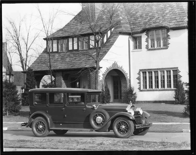 1928 Packard inside drive limousine, seven-eights right front view, on residential street