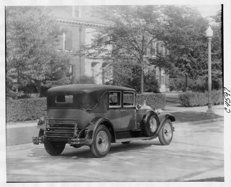 1928 Packard sedan limousine, three-quarter right rear view, parked on residential street