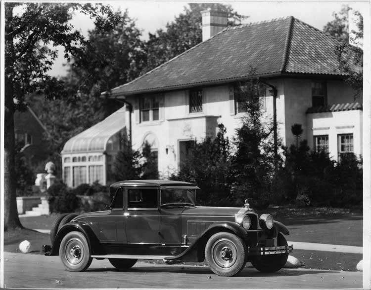 1928 Packard stationary coupe, five-sixths right front view, parked on residential street