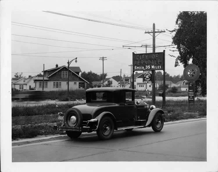 1928 Packard coupe on Woodward Ave. entering city of Ferndale, Mich.