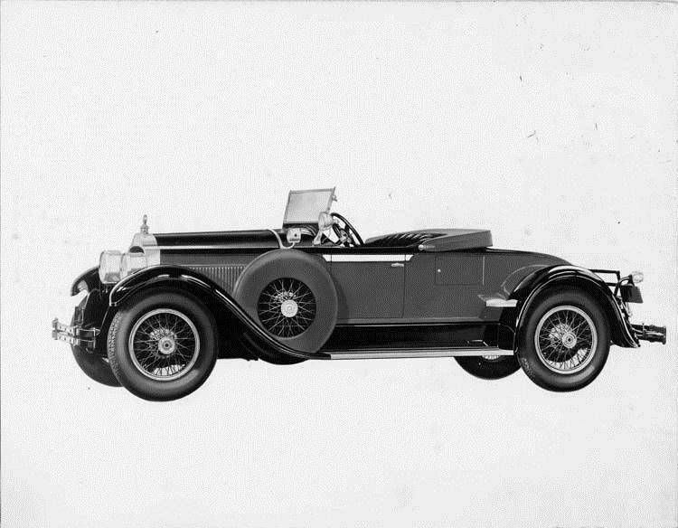 1928 Packard runabout, five-sixths left front view, top lowered, spare carried at side