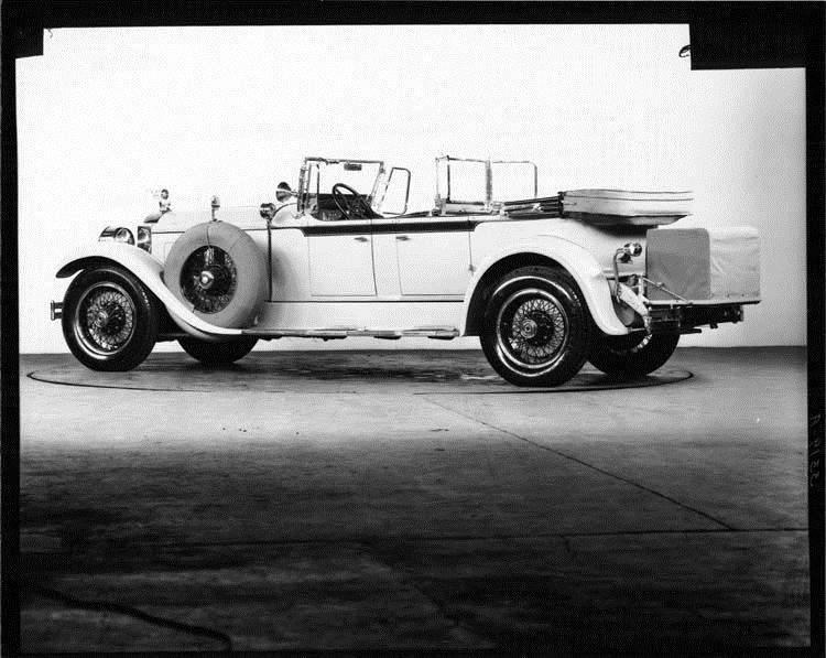 1928 Packard phaeton, three-quarter left rear view, top lowered