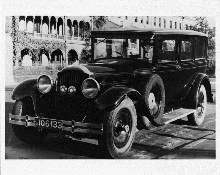 1929 Packard sedan, three-quarter left front view, parked on street