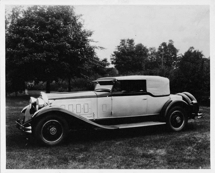 1930 Packard convertible Victoria, seven-eighths left front view, top raised