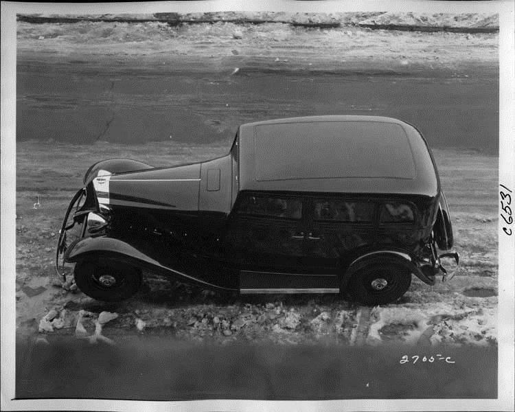 1933 Packard sedan, left side top view, parked on street