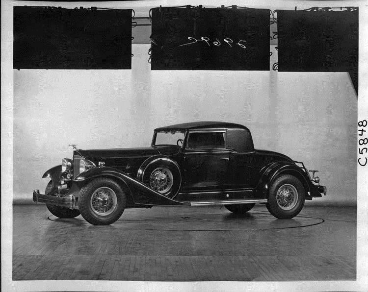 1933 Packard special stationary roof coupe, nine-tenths left side view