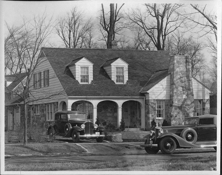 1933 Packard coupes, in driveway and on street in front of house