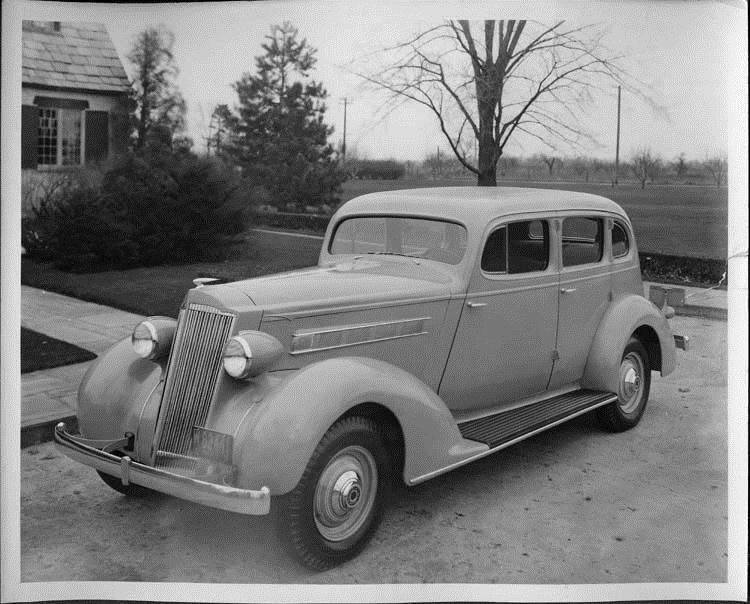 1935 Packard sedan parked by the Lodge at Packard Proving Grounds