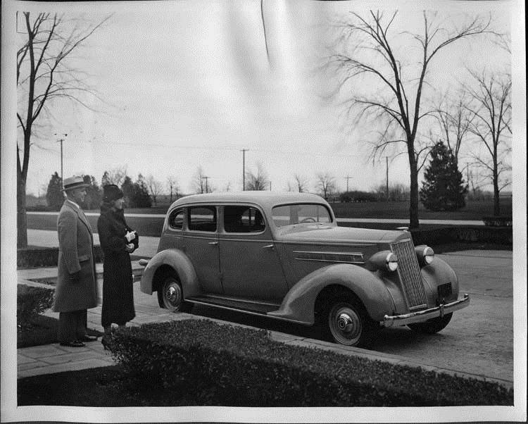 1935 Packard sedan parked by the Lodge at the Packard Proving Grounds