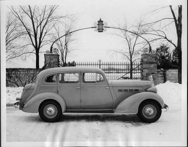 1935 Packard touring sedan at entrance to Packard Proving Grounds