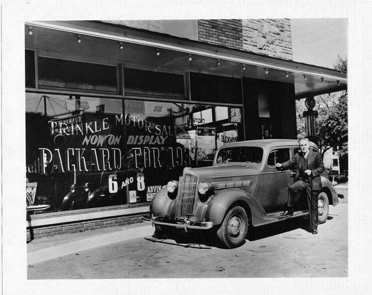 1937 Packard touring sedan, parked in front of Trinkle Motor Sales