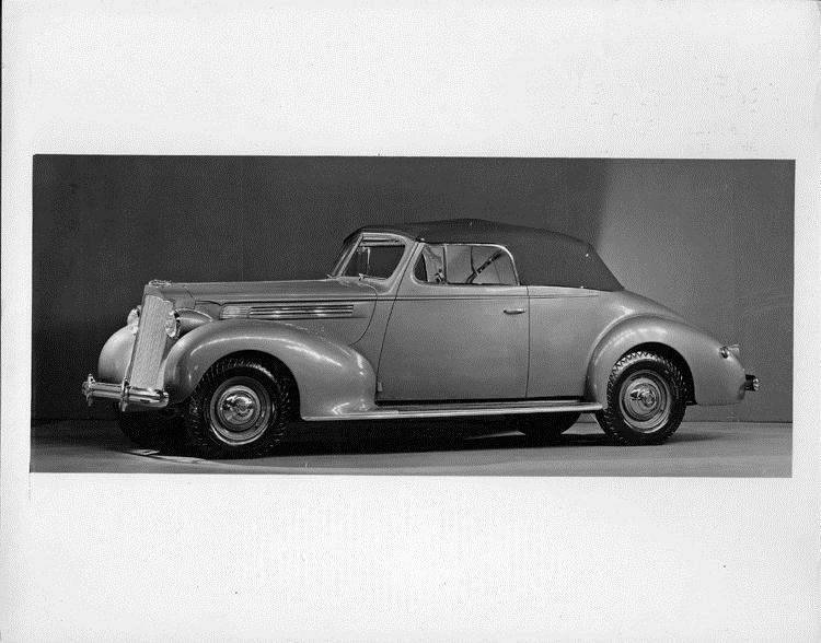 1938 Packard convertible coupe, seven-eights left side view, top raised
