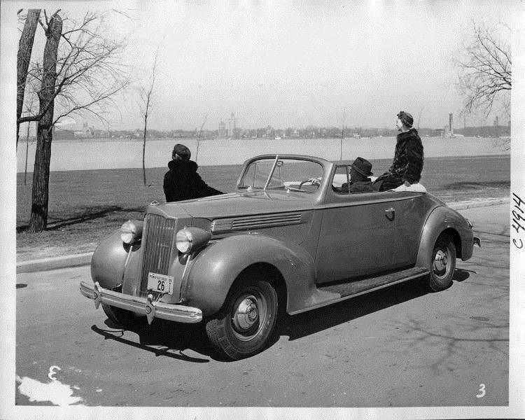 1938 Packard convertible coupe parked by Detroit River on Belle Isle