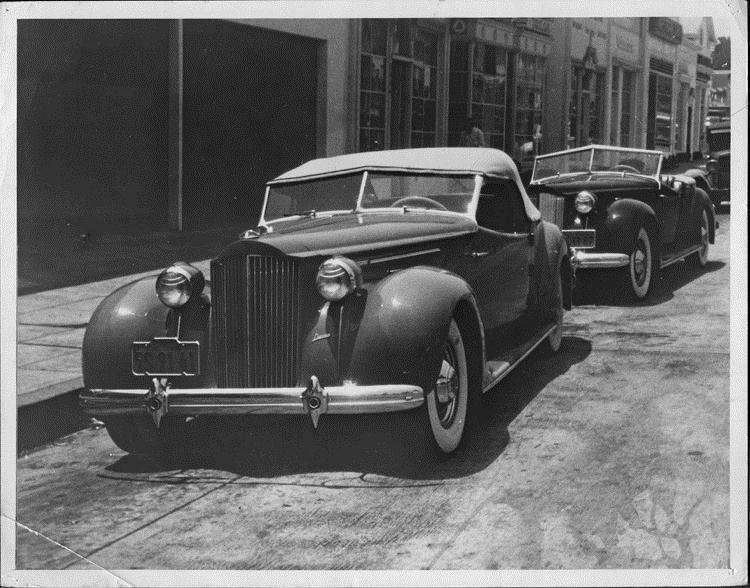 1938 Packard convertible victorias parked on street, front view