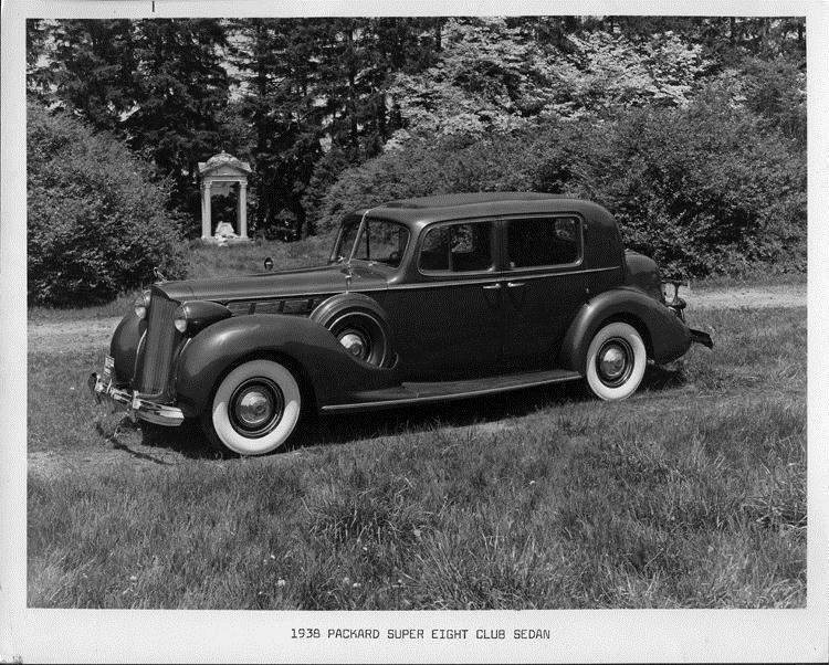 1938 Packard club sedan, nine-tenths left side view, parked on grass