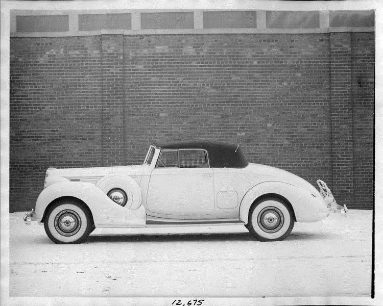 1938 Packard coupe roadster, left side view, top raised, light in color