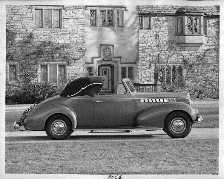 1939 Packard convertible coupe parked in driveway of Alvan Macauley's home