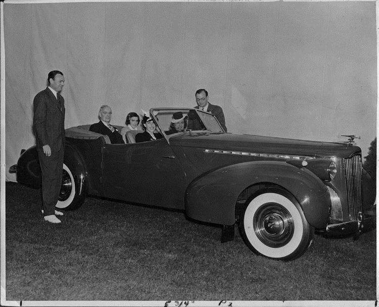 1940 Packard convertible victoria in front of backdrop