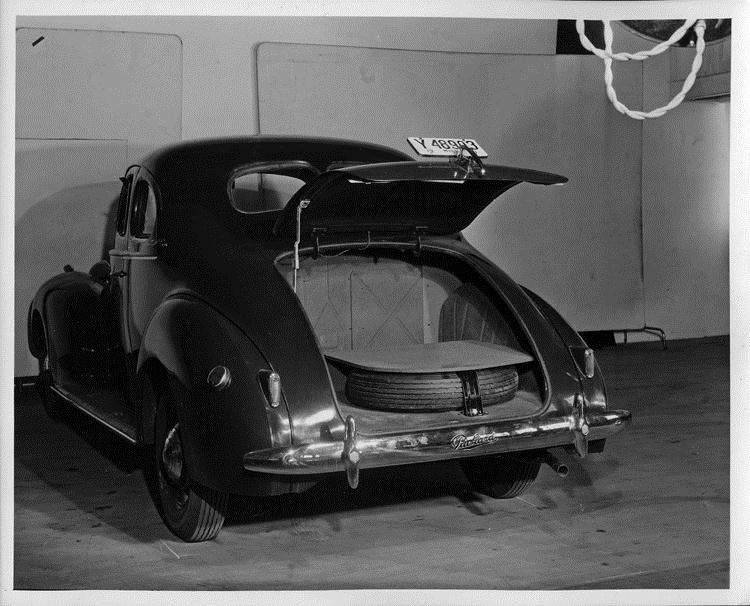 1940 Packard business coupe, rear view showing inside of trunk and spare tire