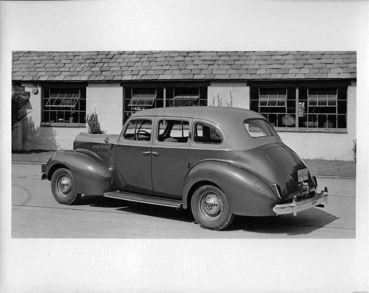 1940 Packard touring sedan, three-quarter rear view