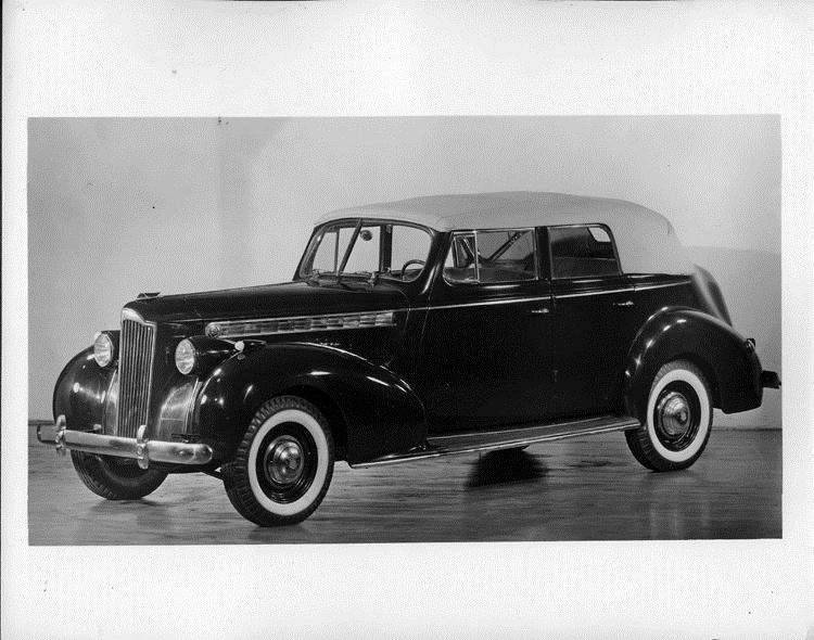 1940 Packard convertible sedan, three-quarter left side view, top raised
