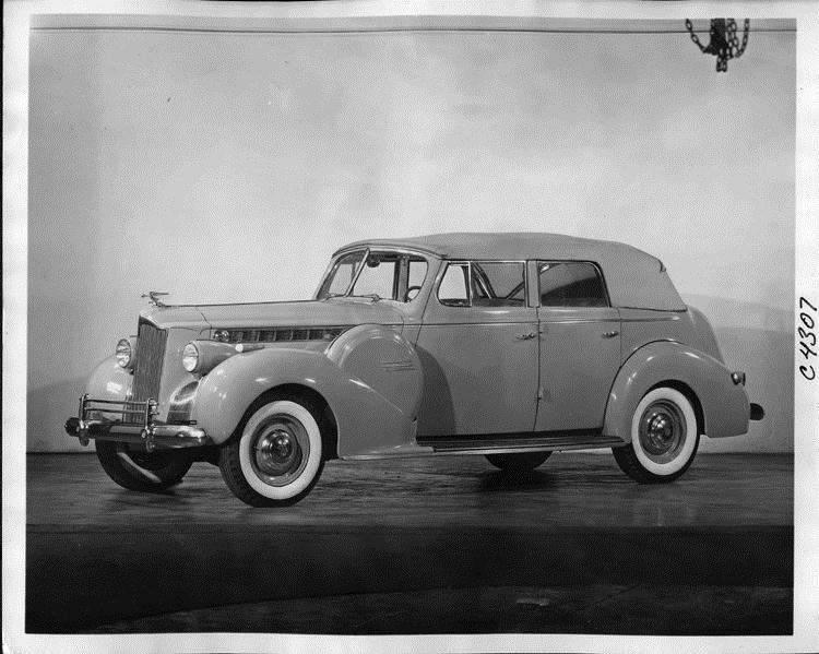 1940 Packard convertible sedan, nine-tenths left side view, top raised