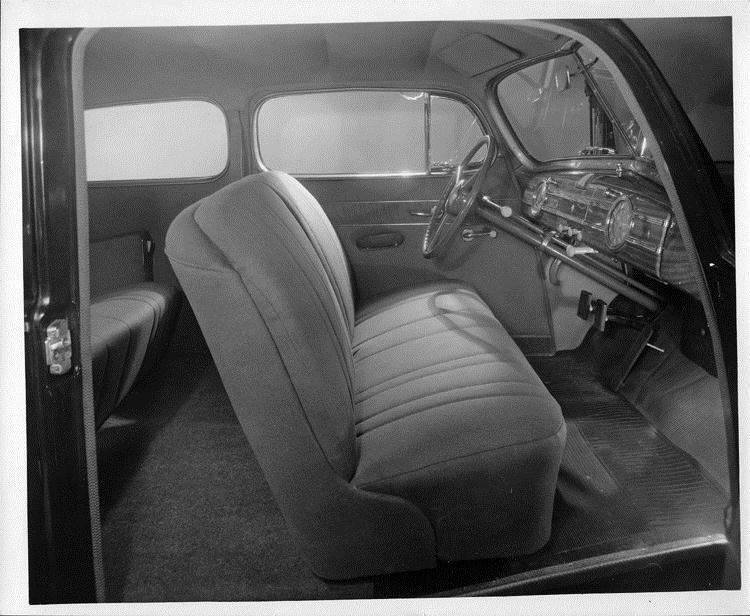 1940 Packard family sedan, view of front interior through passenger side door