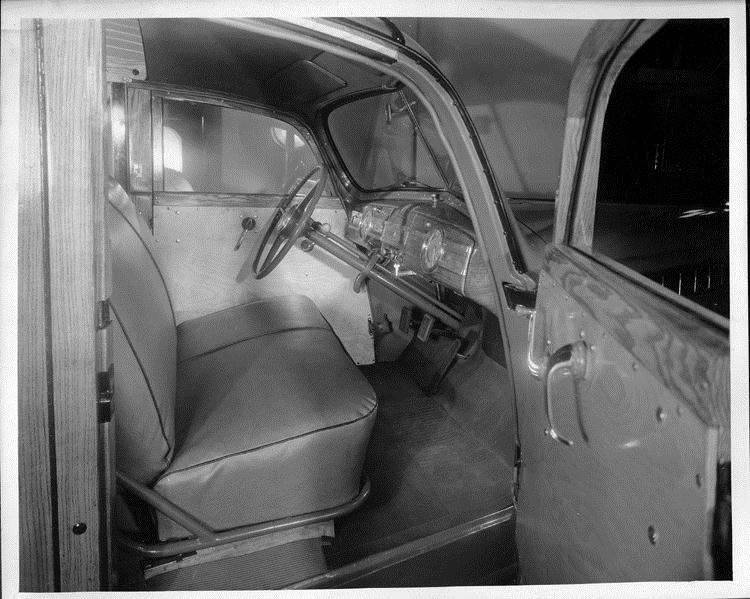 1940 Packard station wagon, view of front interior through passenger side door