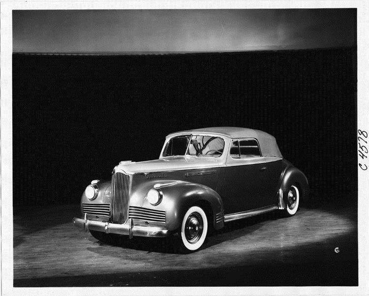 1942 Packard convertible coupe, three-quarter left front view, top raised
