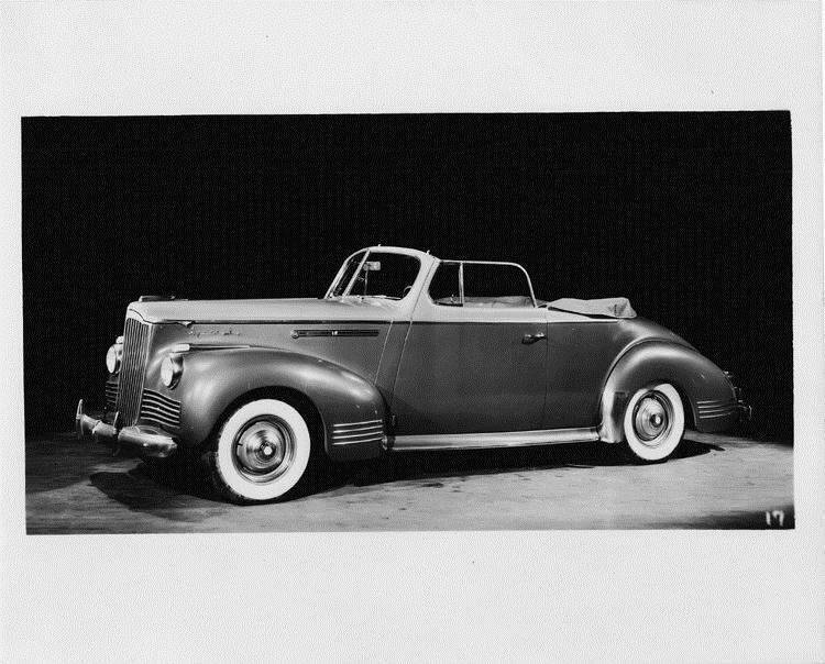 1942 Packard convertible coupe, nine-tenths left front view, top folded