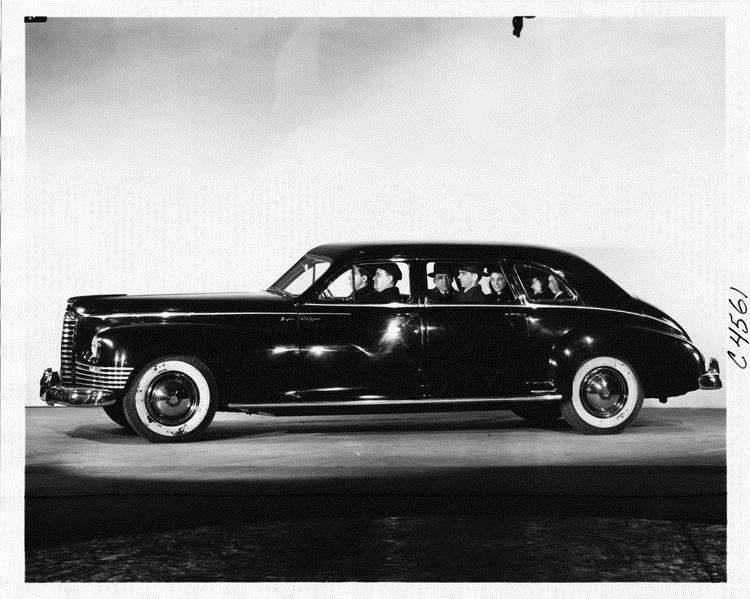 1946 Packard Clipper limousine full of passengers, on display