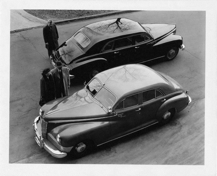 1946 Packard touring sedans, parked on street