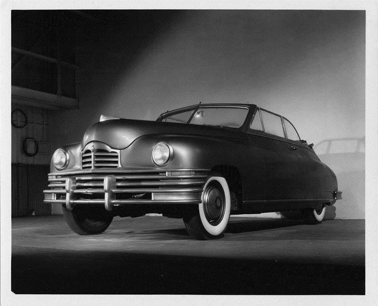 1947 Packard convertible, three-quarter front view from below, dual white sidewall tires