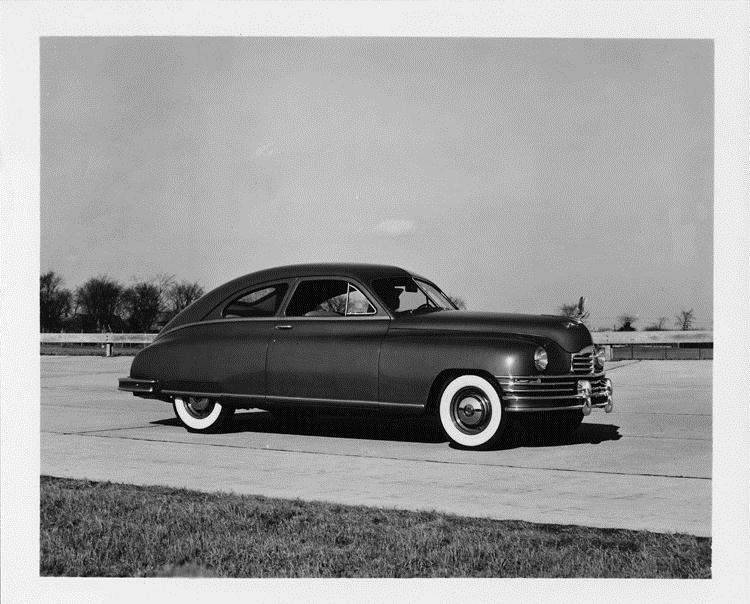 1948 Packard sedan, male behind wheel, on track at Packard Proving Grounds