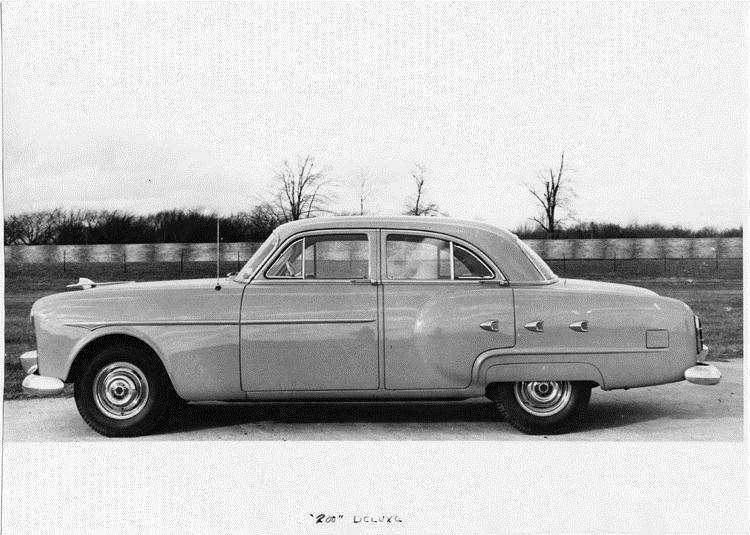 1951 Packard 200 deluxe sedan, left side view, parked on drive