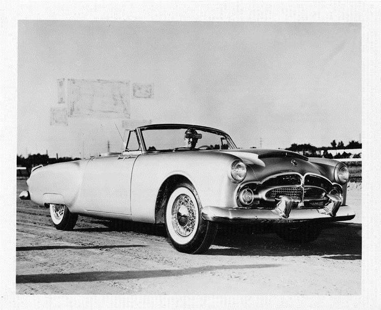 1952 Packard Pan American sports car, seven-eights right side view, man behind wheel
