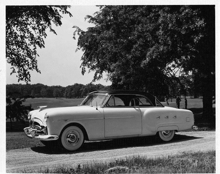 1952 Packard Mayfair sports coupe, nine-tenths left side view, parked on country road